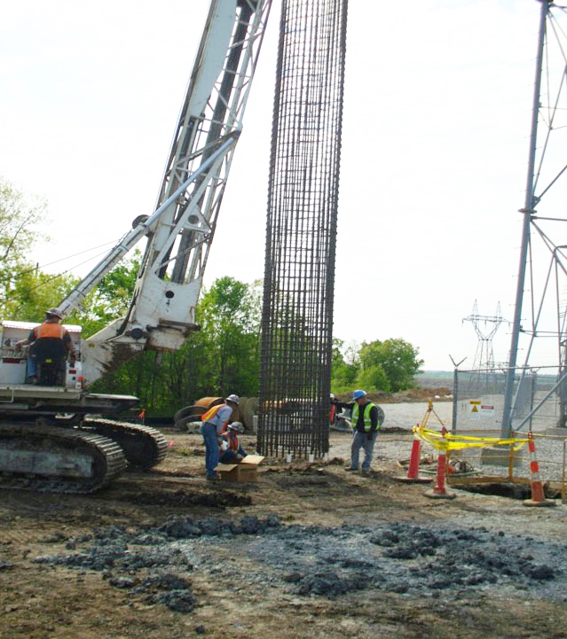 Hayden Tower Service crew installs tower foundation.